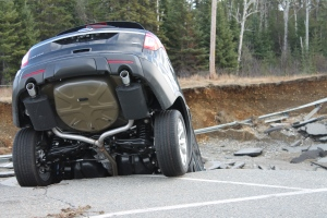 <b>Devastating Rain Damage in Wawa, Ont.</b><br> A state of emergency has been called in the northern Ontario town of Wawa following a record amount of rain. <br><br>Cars are damaged and roads destroyed following heavy rainfall and flooding in Wawa, Ont., Friday, Oct. 26, 2012. (Kristen Sabourin / MyNews.CTVNews.ca)