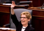 Ontario Premier Kathleen Wynne smiles a waves moments before Ontario Finance Minister Charles Sousa tables the 2013 provincial budget at Queen's Park in Toronto on Thursday, May 2, 2013. (Nathan Denette / THE CANADIAN PRESS)