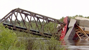 Several cars from a CP train plunged into the Wahnapitae River, near Sudbury, Ont., when a bridge collapsed on Sunday, June 2, 2013. No injuries have been reported so far, but nearby residents were warned not to drink the water from the river. (CTV Northern Ontario)