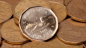 The Canadian dollar appears in this undated file photo. (Jonathan Hayward / THE CANADIAN PRESS)