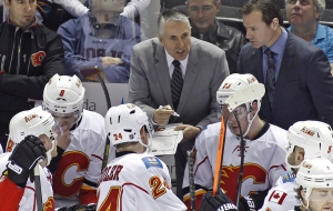 Calgary Flames head coach Bob Hartley speaks to the team near the end of the third period of an NHL hockey game against the San Jose Sharks on Jan. 20, 2014 in San Jose, Calif. (George Nikitin / AP Photo)