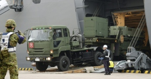 A vehicle carrying a PAC-3 missile interceptor arrives at a port on Ishigaki Island, Okinawa prefecture, southwestern Japan Saturday, Feb. 6, 2016. (Koji Harada/Kyodo News via AP)