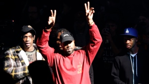 "Kanye West gestures to the audience at the unveiling of the Yeezy collection and album release for his latest album, ""The Life of Pablo,"" Thursday, Feb. 11, 2016 at Madison Square Garden in New York. (AP Photo / Bruce Barton)"