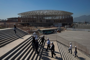 In this June 11, 2015, file photo, the Arena Carioca 1 is seen in the background as officials visit the Olympic Park of the 2016 Olympics in Rio de Janeiro, Brazil. (AP / Felipe Dana)