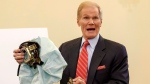 In this Nov. 20, 2014 file photo, Senate Commerce Committee member Sen. Bill Nelson, D-Fla. holds an example of the defective airbag made by Takata of Japan that has been linked to multiple deaths and injuries in cars driven in the U.S. during the committee's hearing on Capitol Hill in Washington. (AP Photo / J. Scott Applewhite, File)
