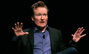 Television host Conan O'Brien gestures to the audience at Sanders Theatre on the campus of Harvard University in Cambridge, Friday, Feb. 12, 2016. (AP / Charles Krupa)