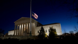 An American flag flies at half-staff in front of the U.S. Supreme Court building in honor of Supreme Court Justice Antonin Scalia as the sun rises in Washington, Sunday, Feb. 14, 2016. Scalia, the influential conservative and most provocative member of the Supreme Court, has died. He was 79. (AP / Manuel Balce Ceneta)