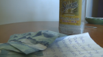 A handwritten note, $25 in cash and the ashes of Gary Robert Dupuis were found in a tequila bottle on a Cape Breton beach on Wednesday, April 27, 2016.