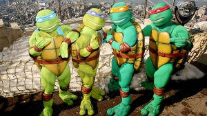 """In this photo released by Warner Brothers Pictures, actors portraying the """"Teenage Mutant Ninja Turtles"""", are photographed on the observation deck of the Empire State Building in New York, Tuesday, March 20, 2007. (AP Photo / Warner Bros. Pictures, Marion Curtis)"""