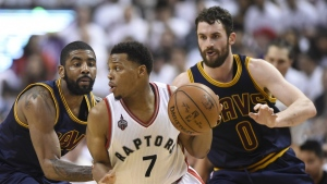 Toronto Raptors guard Kyle Lowry controls the ball as Cleveland Cavaliers forward Kevin Love and Cleveland Cavaliers guard Kyrie Irving defend during second half Eastern Conference final NBA playoff basketball action in Toronto on Monday, May 23, 2016. (Frank Gunn / THE CANADIAN PRESS)