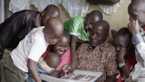 Robert Matanda, subject of the documentary 'Gun Runners' pictured with his family (courtesy NFB)