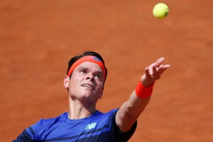 Canada's Milos Raonic serves in his third round match of the French Open tennis tournament against Slovakia's Andrej Martin at the Roland Garros stadium in Paris, France, Friday, May 27, 2016. (AP Photo/Alastair Grant)