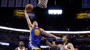 Golden State Warriors guard Klay Thompson (11) shoots over Oklahoma City Thunder center Steven Adams (12) during the second half in Game 6 of the NBA basketball Western Conference finals in Oklahoma City, Saturday, May 28, 2016. The Warriors won 108-101. (AP / Sue Ogrocki)