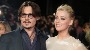 "U.S. actors Johnny Depp, left, and Amber Heard arrive for the European premiere of their film, ""The Rum Diary,"" in London on Nov. 3, 2011. (AP Photo/Joel Ryan, File)"