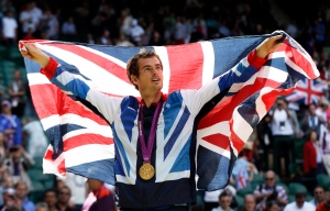 In this Sunday, Aug. 5, 2012 file photo, gold medalist Andy Murray of Great Britain waves the British flag during the medal ceremony of the men's singles event at the All England Lawn Tennis Club at Wimbledon, in London, at the 2012 Summer Olympics. (AP / Elise Amendola)