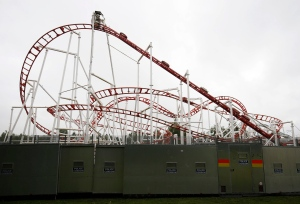 A police screen protects the site of an amusement roller coaster ride derailment at M and D's amusement park in Motherwell, Scotland, Sunday June 26, 2016. (Jane Barlow / PA via AP)