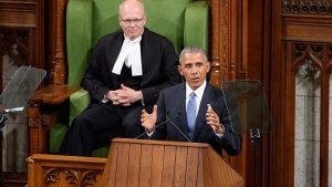 U.S. President Barack Obama addresses the Canadian Parliament in the House of Commons in Ottawa as House Speaker Geoff Regan looks on, Wednesday, June 29, 2016. (Adrian Wyld / THE CANADIAN PRESS)