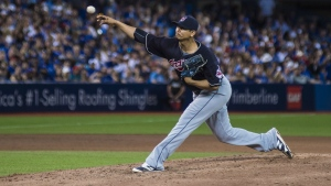 Cleveland Indians' Carlos Carrasco works against the Toronto Blue Jays during eighth inning MLB baseball action, in Toronto on Thursday, June 30, 2016. (Eduardo Lima / THE CANADIAN PRESS)