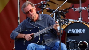 Eric Clapton performs at the 2014 New Orleans Jazz & Heritage Festival at Fair Grounds Race Course in New Orleans on April 27, 2014. (John Davisson / Invision)