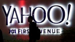 A person walks in front of a Yahoo sign at the company's headquarters in Sunnyvale, Calif. on Nov. 5, 2014. (AP Photo/Marcio Jose Sanchez, File)
