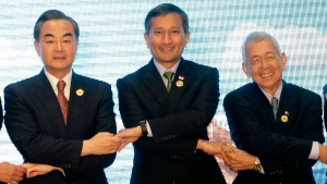 Chinese Foreign Minister Wang Yi, left, Singapore's Foreign Minister Vivian Balakrishnan, center, and Philippine Foreign Secretary Perfecto Yasay Jr., pose for a photo during the Association of Southeast Asian Nations (ASEAN), China Foreign Ministers' Meeting in Vientiane, Laos, Monday, July 25, 2016.  (AP / Sakchai Lalit)