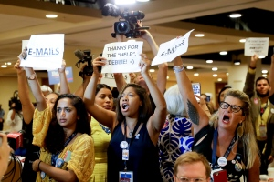 Protesters yell as DNC Chairwoman, Debbie Wasserman Schultz, D-Fla., arrives for a Florida delegation breakfast, Monday, July 25, 2016, in Philadelphia, during the first day of the Democratic National Convention. (AP / Matt Slocum)