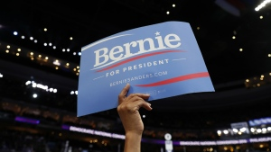 A supporter for Former Democratic Presidential candidate, Sen. Bernie Sanders, I-Vt., holds up a sign during the first day of the Democratic National Convention in Philadelphia  on Monday, July 25, 2016. (AP / Carolyn Kaster)