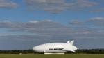 The Airlander 10, part plane, part airship, goes through pre-flight checks at Cardington airfield in Bedfordshire, England, Sunday Aug. 14, 2016. (Joe Giddens/PA via AP)