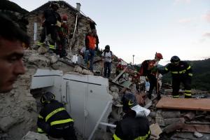 Rescuers search through debris following an earthquake in Pescara Del Tronto, Italy, Wednesday, Aug. 24, 2016. (AP Photo/Andrew Medichini)