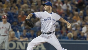 Toronto Blue Jays starting pitcher J.A. Happ throws against the Los Angeles Angels during the first inning of their American League MLB baseball game in Toronto on Thursday, August 25, 2016. (Fred Thornhill / THE CANADIAN PRESS)
