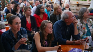 A group of Democrats gather to watch Hillary Clinton and Donald Trump face off in the first 2016 Presidential debate, at Rooftop Brewing Company in Seattle, Wash., on Monday, Sept. 26, 2016. (Genna Martin/seattlepi.com via AP)