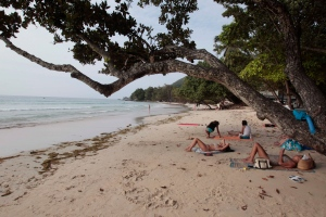 In this file photo, tourists are seen on the beach of Beau Vallon in the Seychelles Island, Wednesday, Feb. 29, 2012. (AP Photo/Gregorio Borgia)