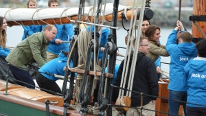The Duke and Duchess of Cambridge help to raise the sails on a tallship, in Victoria on Saturday, October 1, 2016. THE CANADIAN PRESS/Jonathan Hayward