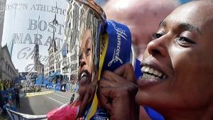 Rita Jeptoo of Kenya poses with her trophy at the finish line of the 2013 Boston Marathon, on April 15, 2013. (Elise Amendola / AP)
