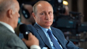 Russian President Vladimir Putin attends a meeting of the Russian People's Front movement in the Black Sea resort of Yalta, Crimea, on Oct. 26, 2016. (Alexei Druzhinin / Sputnik, Kremlin Pool Photo via AP)
