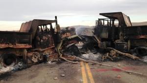 The burned hulks of heavy trucks sit on Highway 1806 near Cannon Ball, N.D., on Oct. 28, 2016. (James MacPherson / AP)