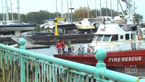 Police recover a body from Lake Ontario after a vehicle veered across traffic and hit a guardrail before plunging into the water.