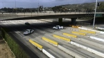 United States Customs and Border Protection officials block access to Tijuana, Mexico, at the San Ysidro Port of Entry on Sunday, Jan. 22, 2017. (AP / Elliot Spagat)