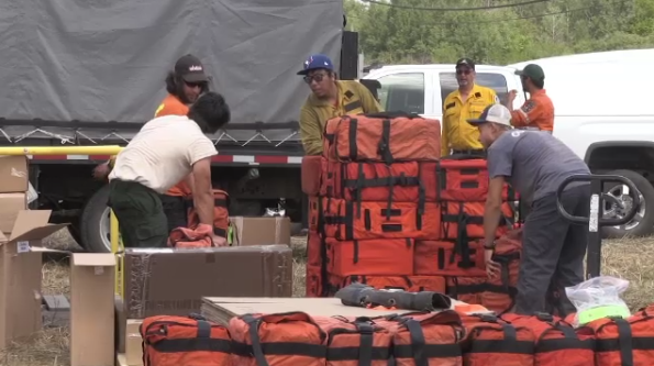 Crew loads up MNRF helicopter with supplies