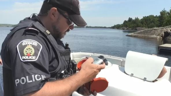 Constable Tremblay checks equipment on board