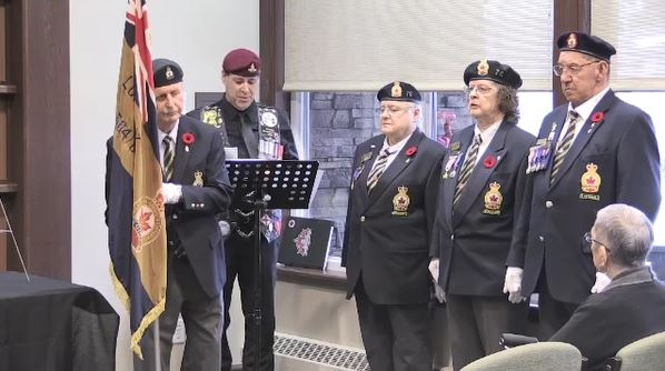 Dan Draper reads veterans names at ceremony