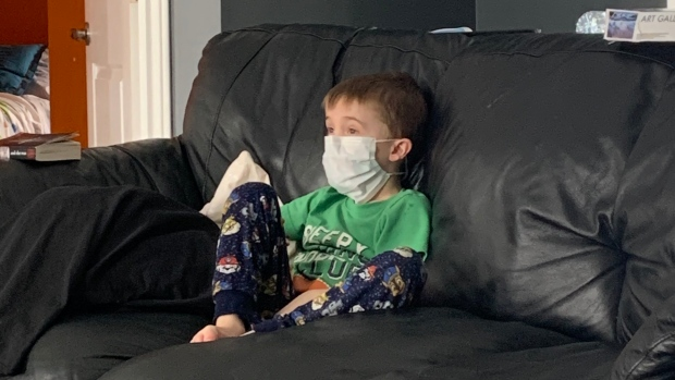 Jasen Larocque's son at home in quarantine