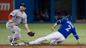 Toronto Blue Jays Kelly Johnson slides safely under the tag of Boston Red Sox second baseman Nick Punto as he steals second base during first inning MLB action in Toronto on Sunday, June 3, 2012. THE CANADIAN PRESS/Aaron Vincent Elkaim