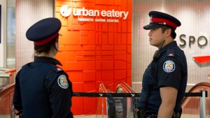 Police investigate after a man was shot and killed inside the Eaton Centre on Saturday June 2, 2012. (THE CANADIAN PRESS)