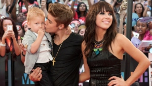 Justin Bieber kisses his brother Jaxon as he poses with Carly Rae Jepsen on the red carpet during the 2012 Much Music Video Awards in Toronto on Sunday, June 17, 2012. Chris Young / THE CANADIAN PRESS